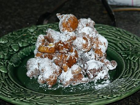 Drop doughnut recipe sprinkled with powdered sugar.