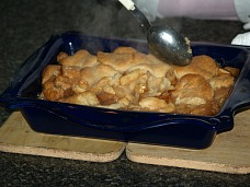 apple pandowdy mixing out of oven