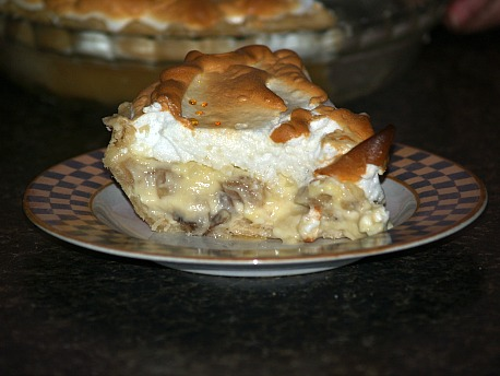 pice banana cream pie topped with meringue