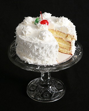 coconut layer cake grating the fresh coconut cake fresh coconut is her ...