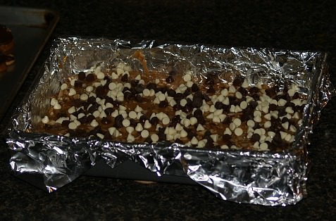 Chocolate and Vanilla Chips Sprinkled Over Hot Toffee