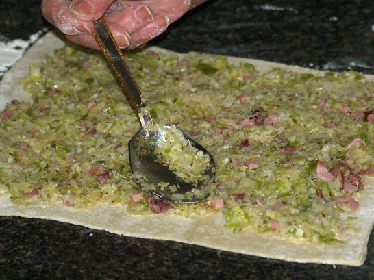Spread Cabbage and Ham over Dough