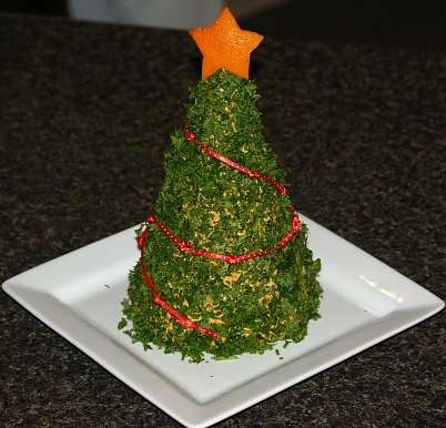 christmas tree made of cheese serve with party crackers