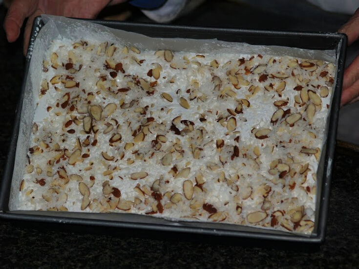 Sprinkle Top with Toasted Coconut and Almonds
