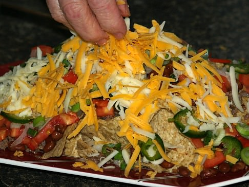 Sprinkle Cheese Over Nachos