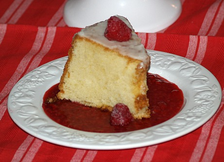 lemon pound cake topped with a and served with raspberry sauce