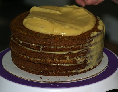 Putting Almond Filling Between Layers and Coating Top and Sides