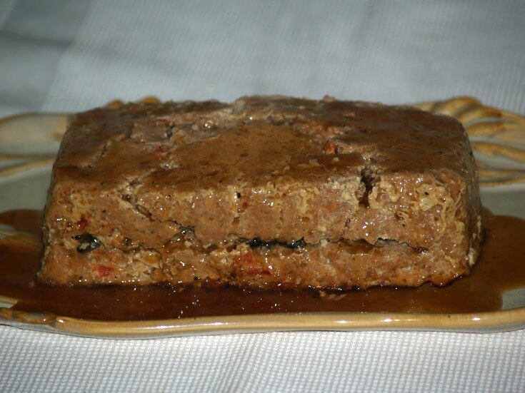 Mushroom Stuffed Meatloaf served with a Red Wine Sauce