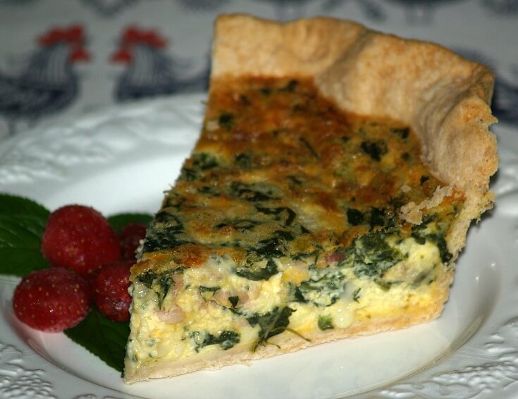Cut Piece of a Bacon Spinach Quiche