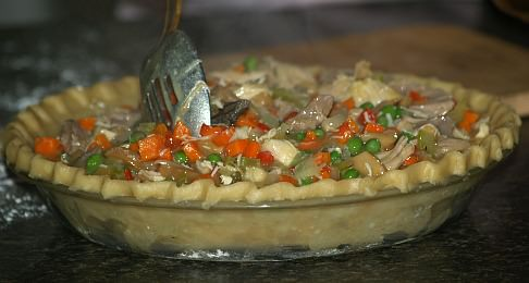 Putting the Filling in the Pie Crust for Turkey Pot Pie