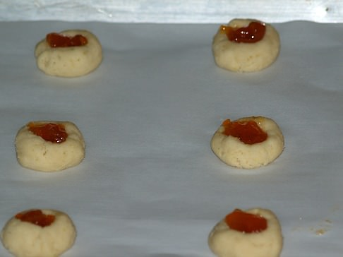 Unbaked Thumbprint Cookies Filled with Apricot
