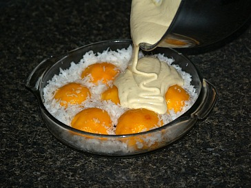 Pouring Batter Over Coconut and Peaches