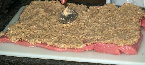Spread Stuffing Over Loin
