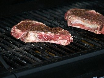 Barbequeing Steaks on the Grill
