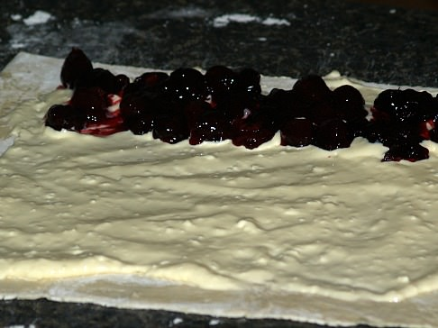 Cheese Spread on Puff Pastry with Row of Cherries