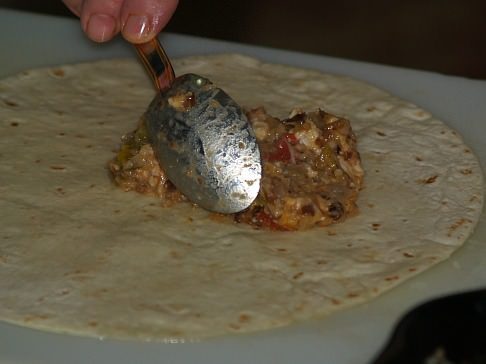 Fill Tortilla with Cooked Filling