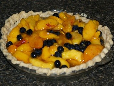 Fresh Peach and Blueberry Pie Filling in Baked Pie Crust