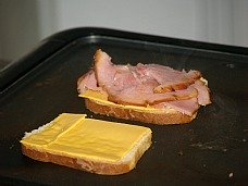 making a grilled ham and cheese sandwich