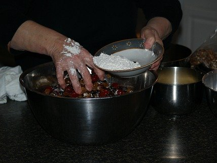 Dredging the fruit in flour