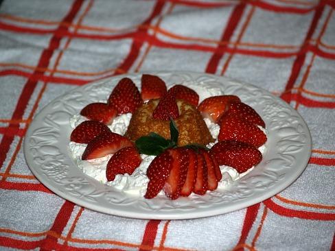 moist vanilla cupcake served with strawberries and cream
