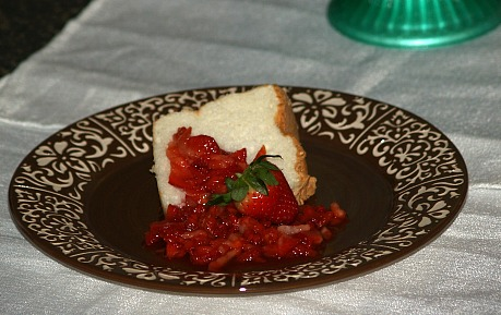 Piece of angel food cake served with strawberries