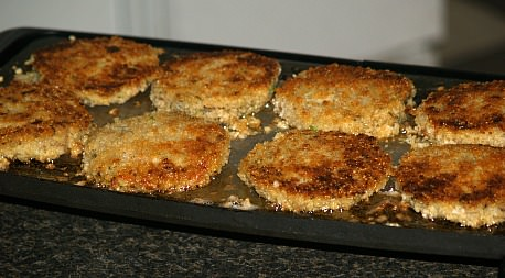 Zucchini Patties Frying on Griddle